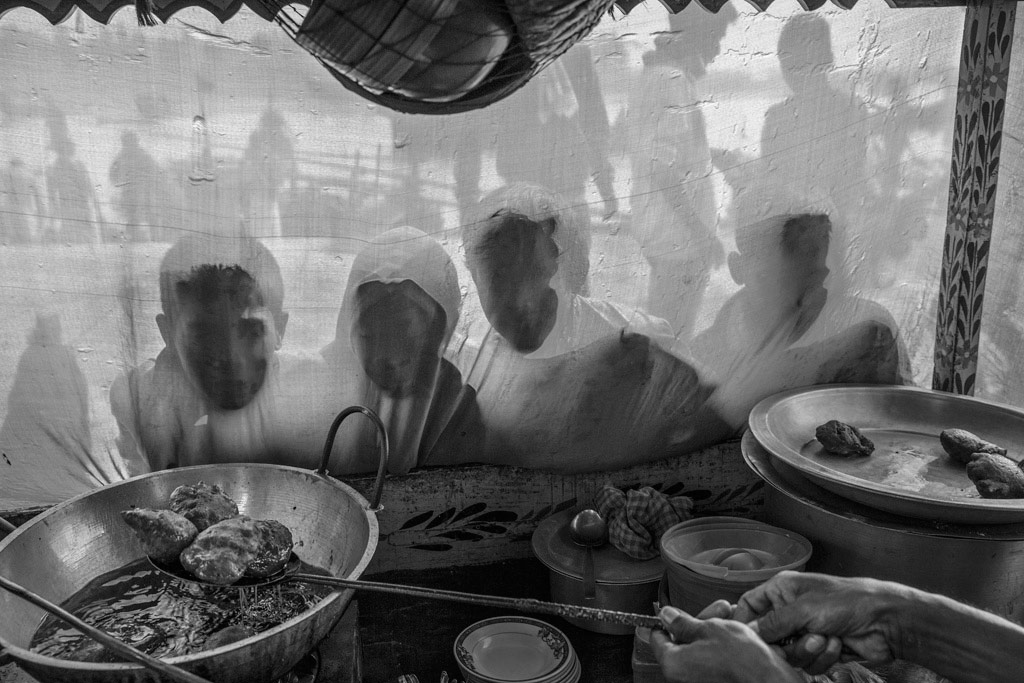 Temptation of Food, © Rongguang Ye, China, 1st Place, B&W Child Photo Contest