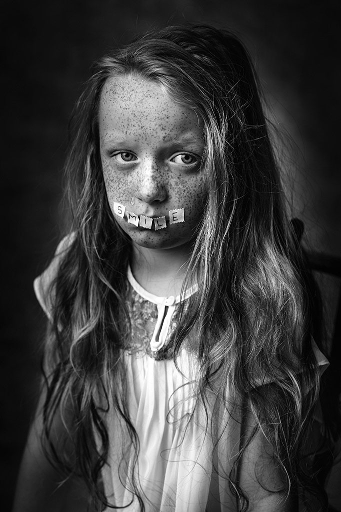 Smile Through Tears, © Kamila Celary-Kmiecik, Poland, 2nd Place, B&W Child Photo Contest