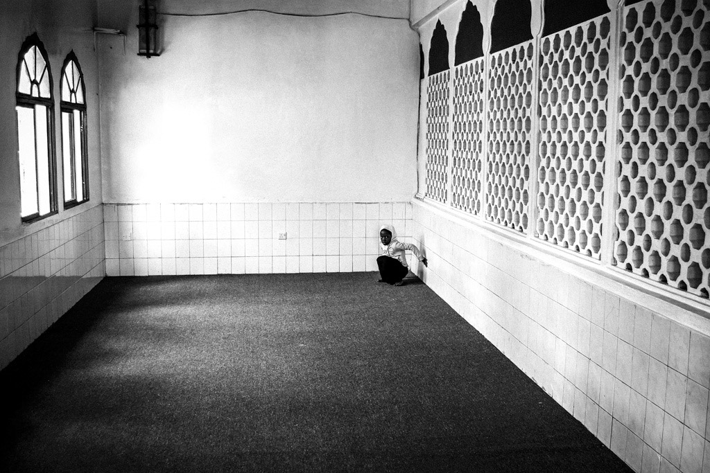 Girl in the corner, © Marcel Kolacek, Czech Republic, 3rd Place, B&W Child Photo Competition