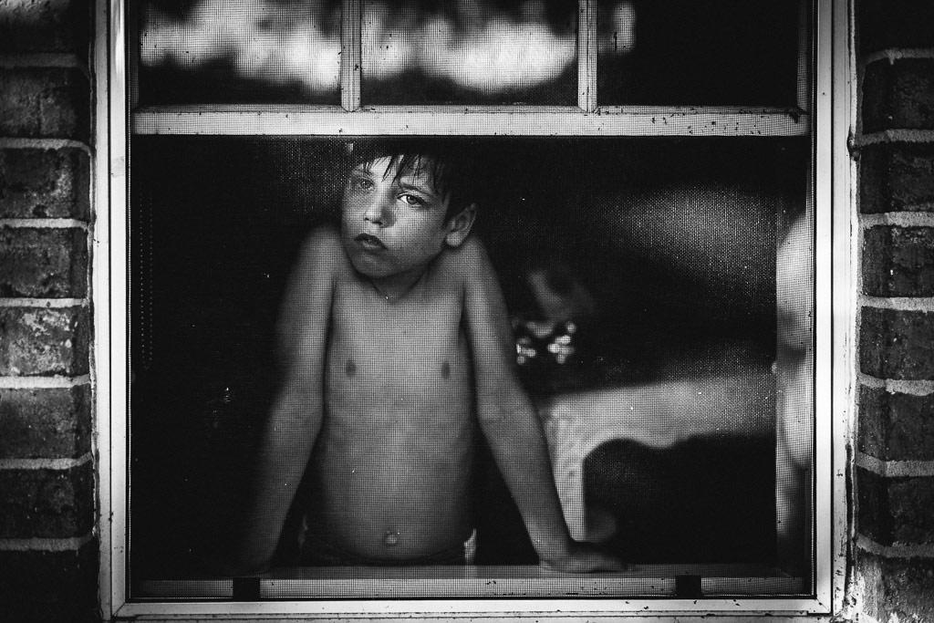 Window Frame, © Nichole Quinn, USA, B&W Child Photo Contest