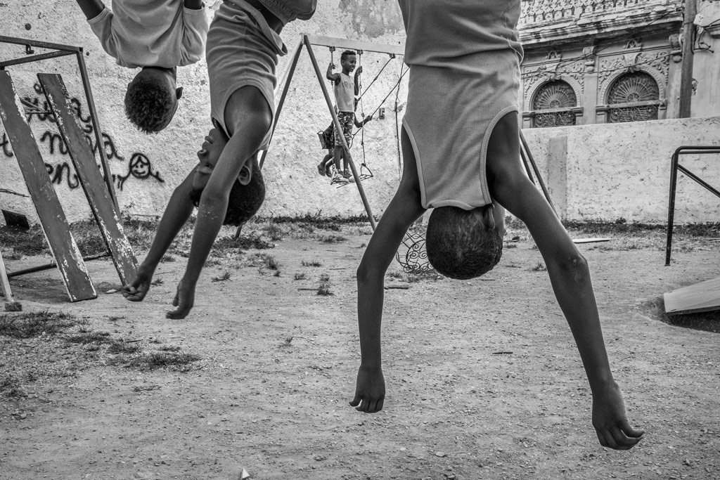 Play 2, © Yonghong Jin, China, 3rd Place, B&W Child Photo Contest