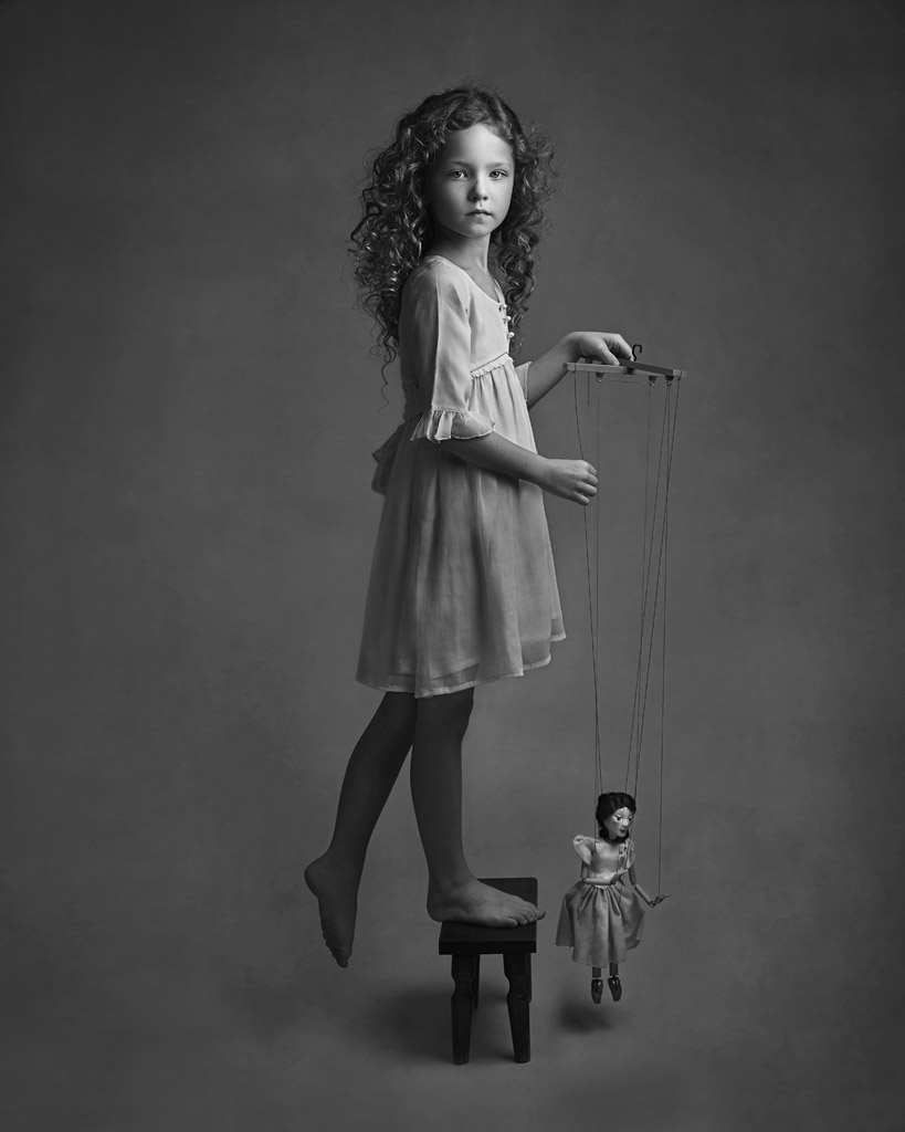 Delilah and the Puppet, © Lisa Visser, UK, Honorable Mention in the Portrait Category, 2nd Half, B&W Child Photo Contest