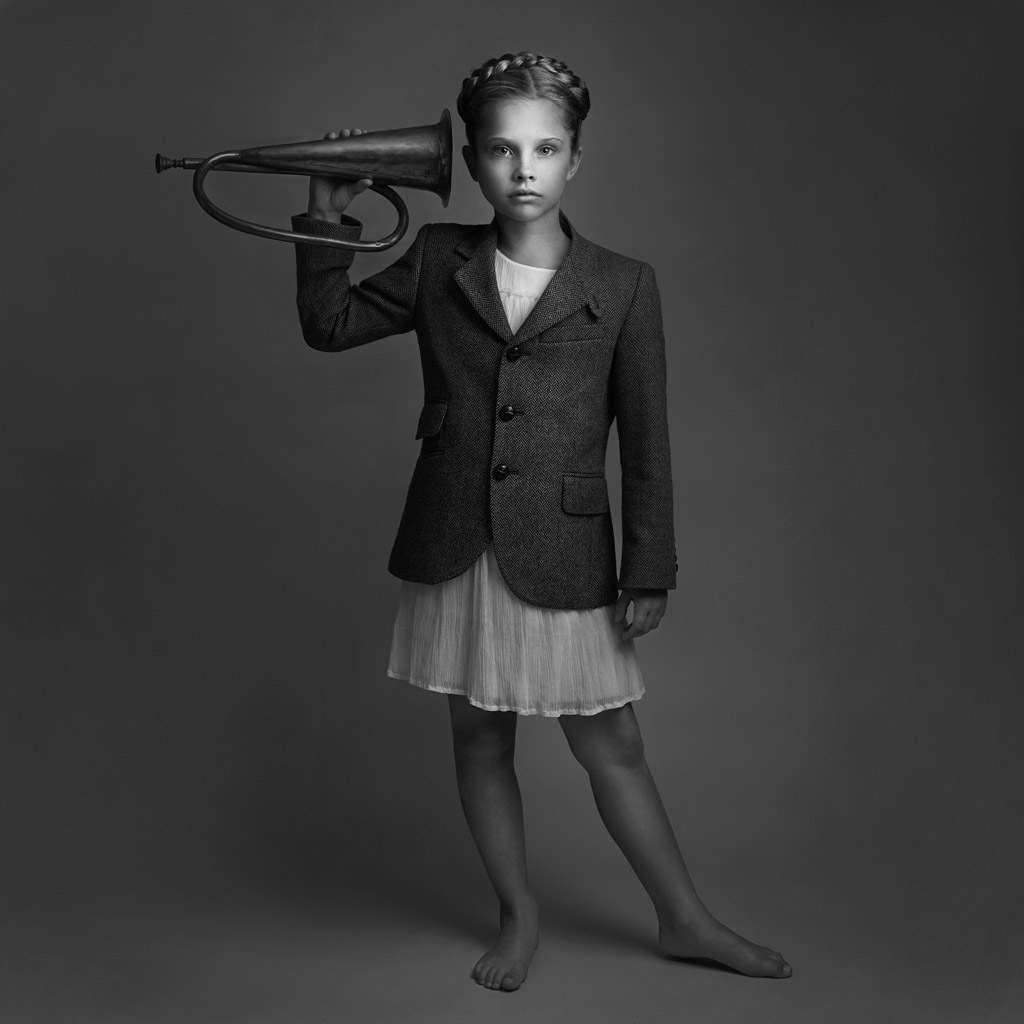 The Girl and the Bugle, © Lisa Visser, UK, 3rd Place in the Fine Art Category, 2nd Half, B&W Child Photo Contest