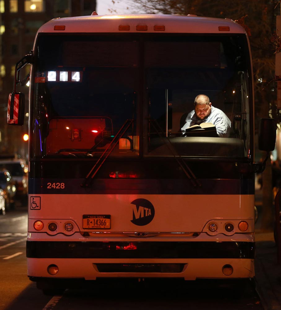 """Bus Driver, Tribeca, NYC 2013"". Project: The Art of Reading series, © Lawrence Schwartzwald, New York, NY, Center — Review Santa Fe 2017"