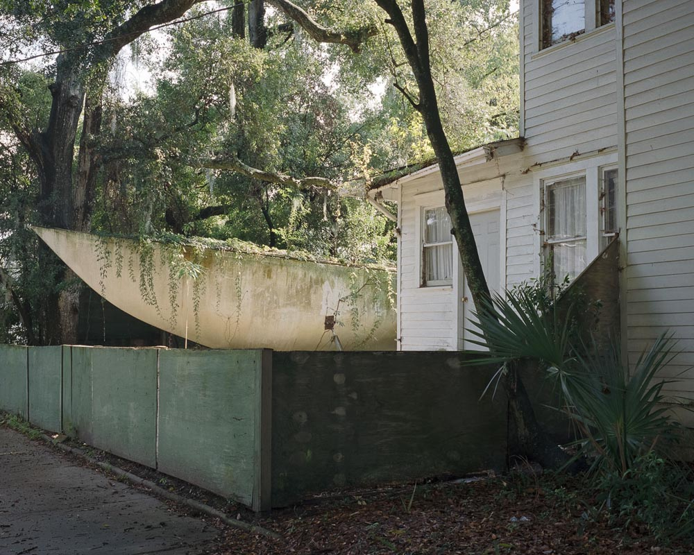 """Who would keep a backyard boat?"". Project: Stranger Come Home, © Ward Long, Oakland, CA, Center — Review Santa Fe 2017"