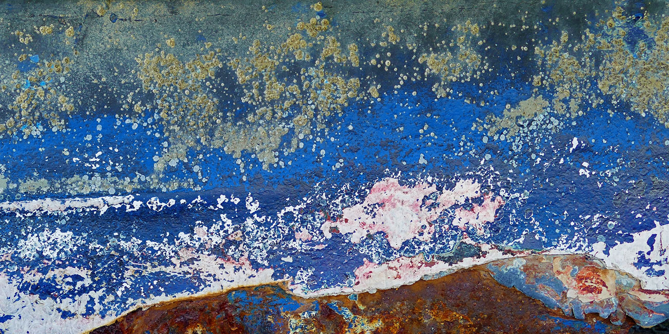 © Rainer Stark, Across The Ocean For A Better Life – Impression of a rusted boat hull, Photography 24 x 47, The Chelsea International Photography Competition