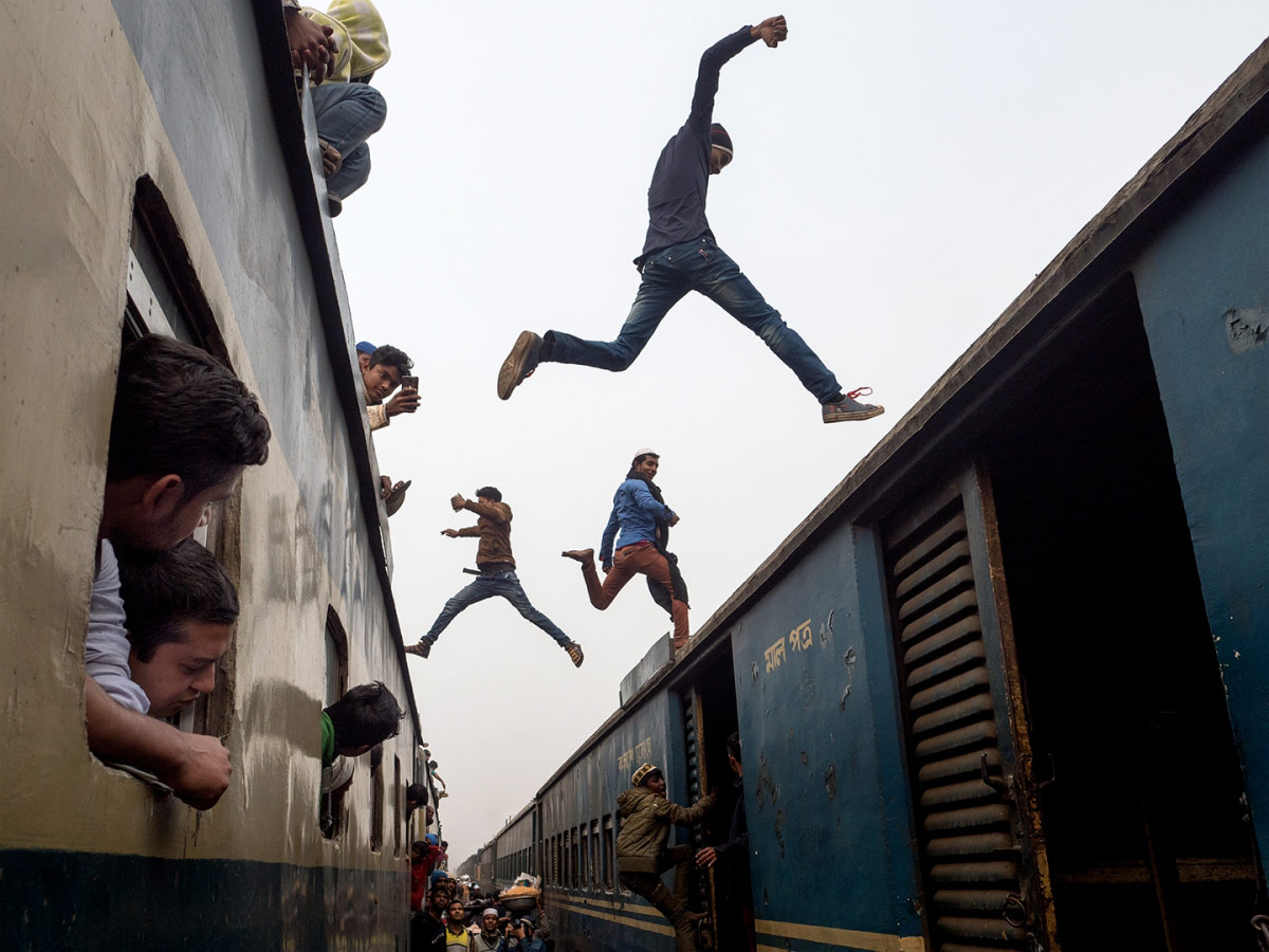 1st Place Photojournalism, © Marcel Rebro, Slovakia, Train jumpers, Chromatic Awards - International Color Photography Contest