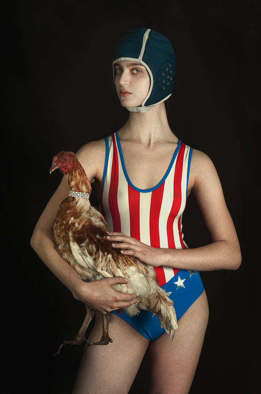 The Woman and The Hen, © Romina Ressia, Argentina, 1st Place - Outstanding Achievement, 1st Place - Photographer Of The Year, International Color Awards