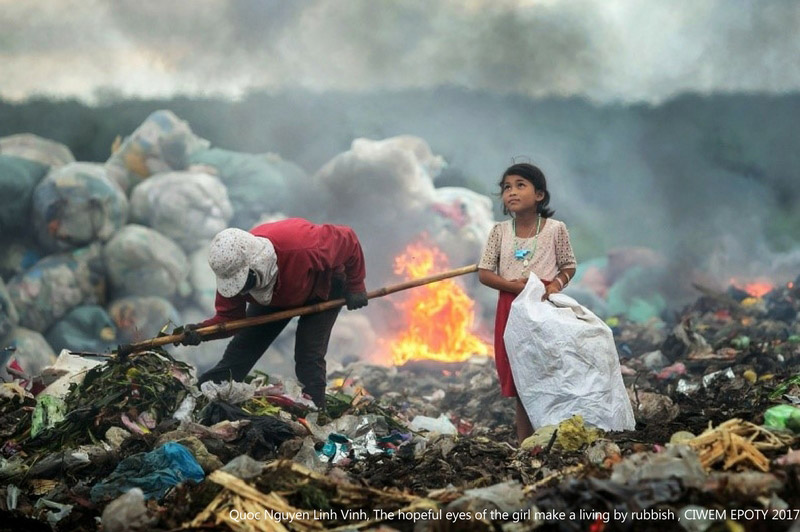 """The hopeful eyes of the girl making a living by rubbish"", © Quoc Nguyen Linh Vinh, Environmental Photographer of the Year, Environmental Photographer of the Year — EPOTY"