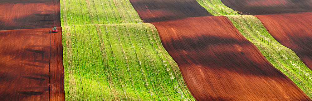 The hard work of the tractor driver Ciprian, © Jan Šmíd, 1st Place Winner Panoramic professional, Fine Art Photography Awards