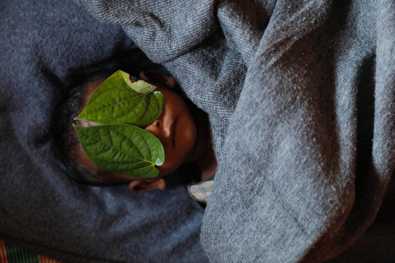 Boy / Bangladesh, © Damir Sagolj / Reuters, Bosnia and Herzegovina, Photo of the Year 2018, Single News 1st Prize, Istanbul Photo Awards