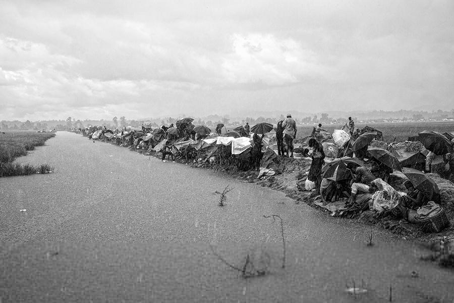 Under the rainstorm - Rohingya's exodus, © Erberto Zani, Switzerland, Photojournalism Photographer of the Year 2017, Monochrome Photography Awards