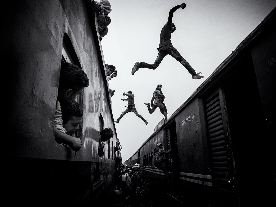 Train Jumpers, © Marcel Rebro, 1st Place - Black & White Travel Photo of the Year 2018, MonoVisions Photography Awards