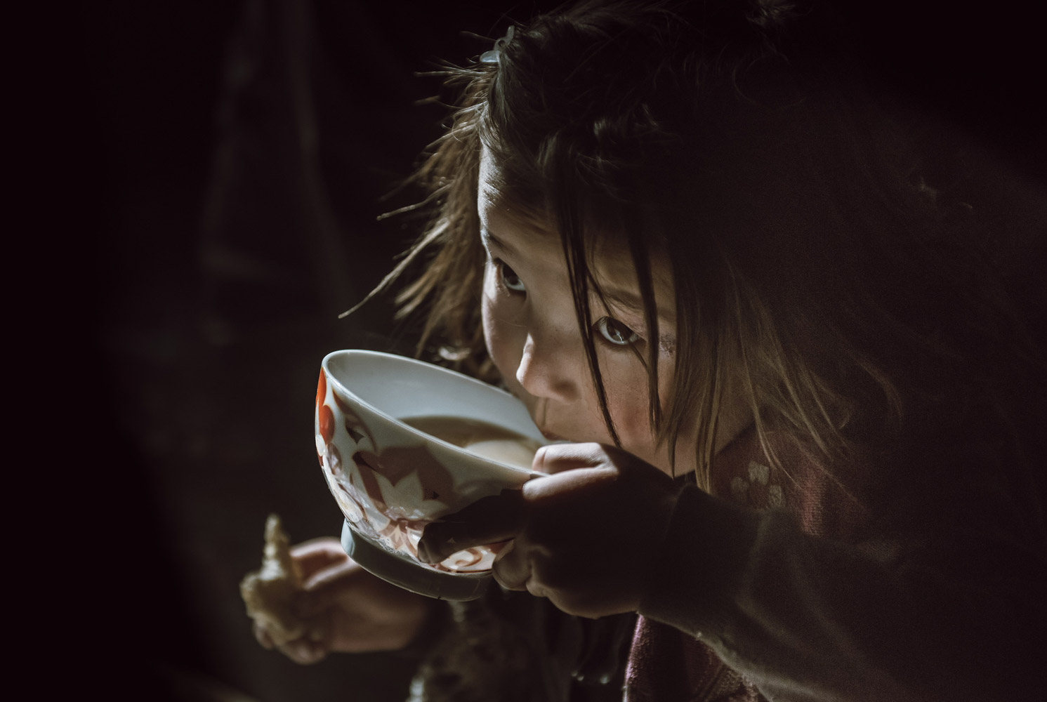Kazakh Girl Drinking Her Morning Tea, © Atul Prasad, San Diego, CA, United States, First Place Amateur : Babies/Children, PDN Faces - Portrait Photography Contest
