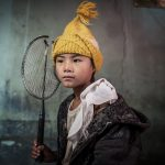 Nepali Nintendo, © Simon Sharp, Croston, Lancashire, United Kingdom, Professional : Babies/Children, PDN Faces - Portrait Photography Contest