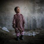 Nepali Nintendo, © Simon Sharp, Croston, Lancashire, United Kingdom, Professional : Babies/Children, PDN Faces - Portrait Photography Contest