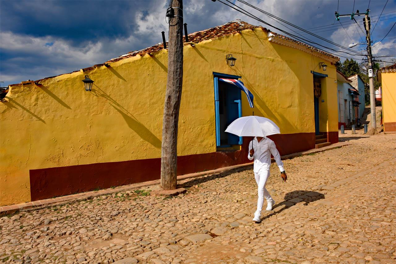 Dandy in Front of Yellow House, Trinidad, Cuba, © Jean-Michel Rendu, Santa Fe, NM, Santa Fe Photographic — Summer vacation