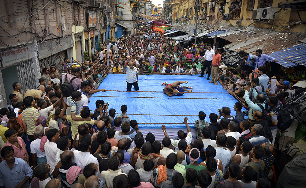 Street Wrestling, © Amit Moulick, India, 3rd place : Sports : Single, Andrei Stenin International Press Photo Contest