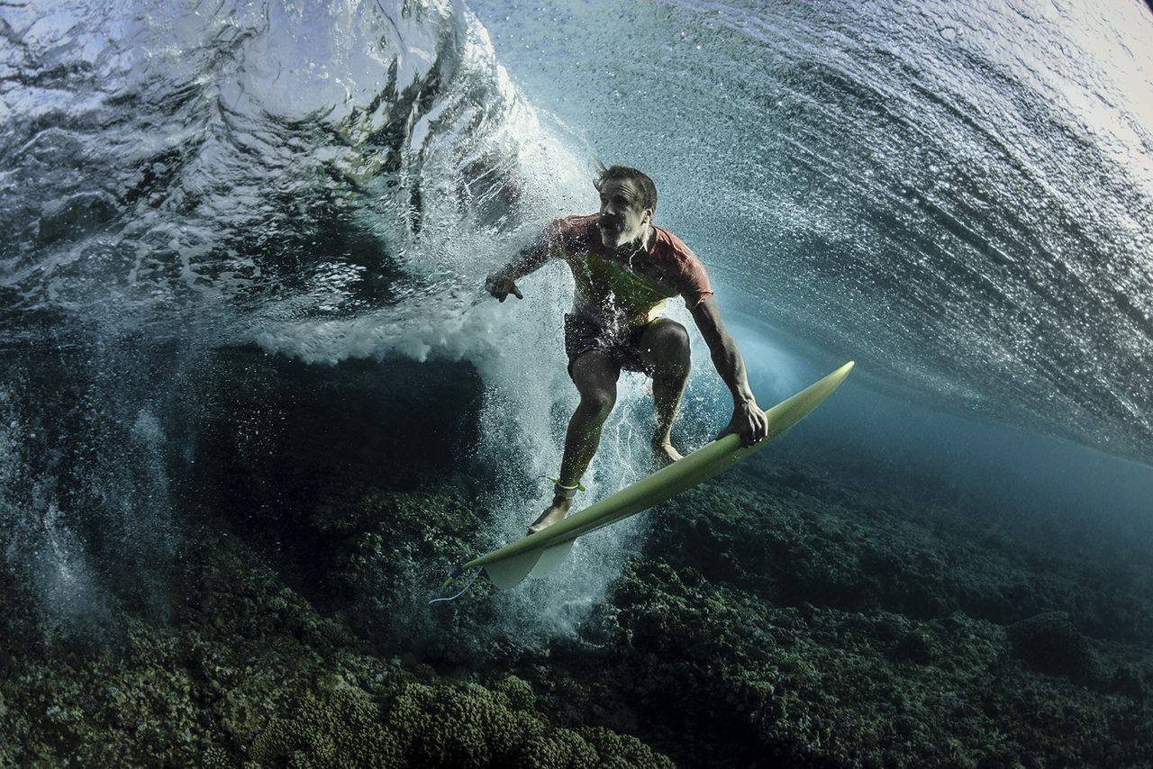 Under The Wave, © Rodney Bursiel, Third Place Winner, People, National Geographic Travel Photographer of the Year