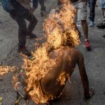 Demonstrator Catches Fire, © Juan Barreto, Venezuela, 3rd prize stories, World Press Photo Contest