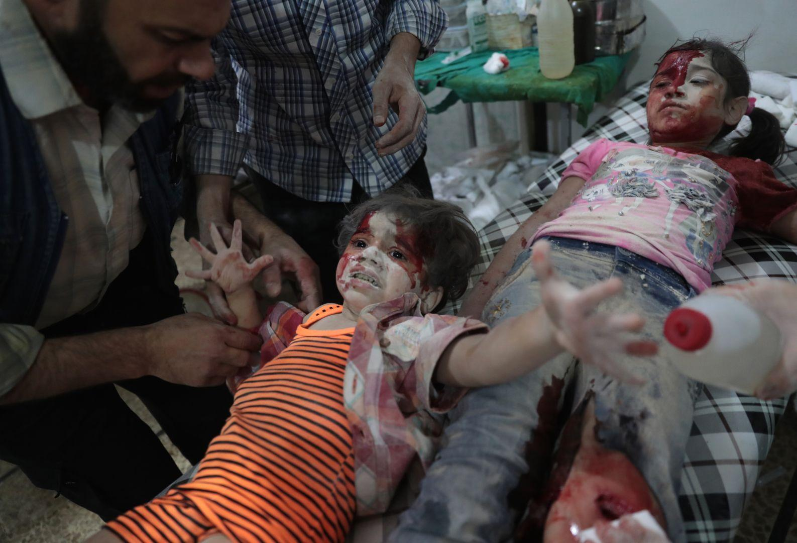 Medics Assist a Wounded Girl, Abd Doumany, Syria, The World Press Photo Contest